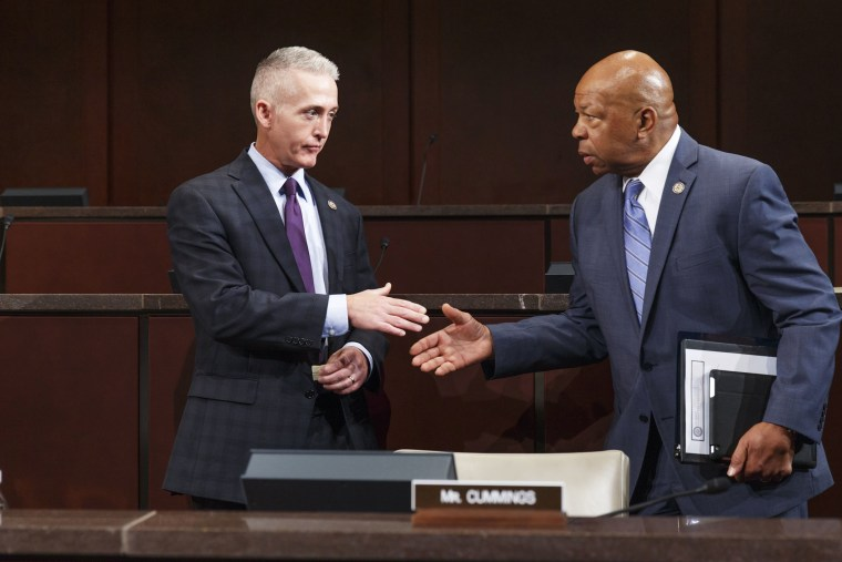 Rep. Trey Gowdy and Rep. Elijah Cummings arrive as the panel holds its first public hearing to investigate the 2012 attacks on the U.S. consulate in Benghazi, Libya, Sept. 17, 2014.