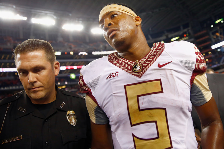 Jameis Winston of the Florida State Seminoles walks off the field after a game at AT&T Stadium on Aug. 30, 2014 in Arlington, Texas.  Photo by Tom Pennington/Getty