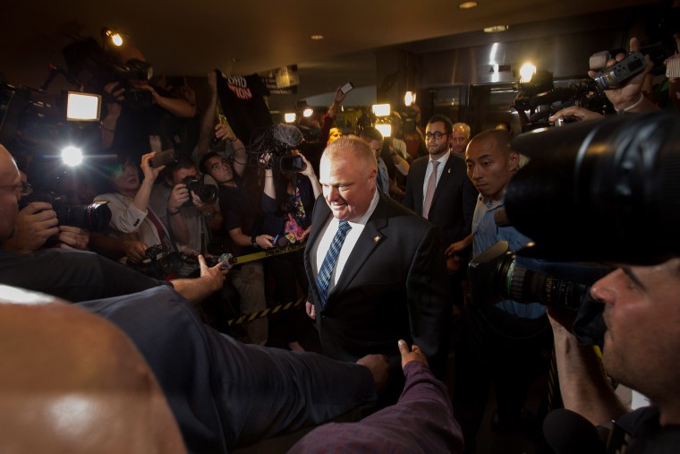 Toronto Mayor Rob Ford arrives at his office at city hall in Toronto on June 30, 2014 amid a crush of cameras.