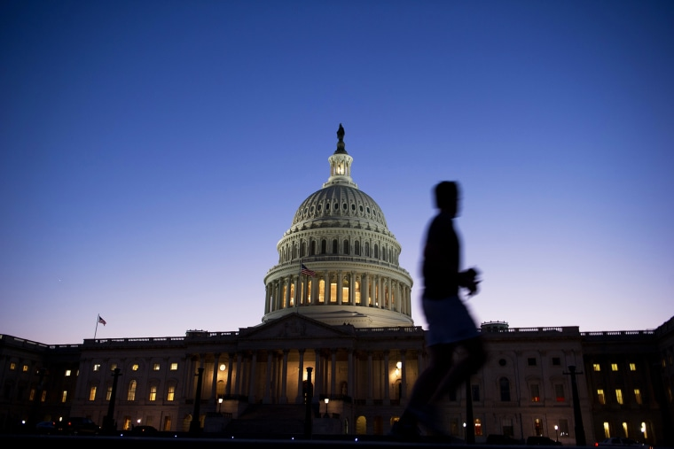 A man jogs past the U.S. Capitol in Washington, D.C., on Sept. 30, 2013.