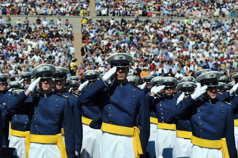 US Air Force cadets salute during the commencement address at the US Air Force Academy in Colorado Springs, Colo., on May 23, 2012. (Photo by Jewel Samad/AFP/Getty)