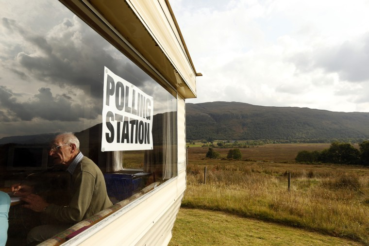 Poll clerk George MacKay sits in the Coulags caravan polling station, in the Scottish Highlands Sept. 18, 2014.