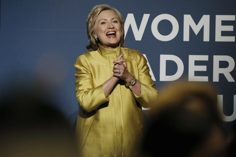 Former U.S. Secretary of State Hillary Clinton reacts to the cheers of the crowd as she arrives to address the Democratic National Committee's Women's Leadership Forum annual Issues Conference in Washington, Sept. 19, 2014.