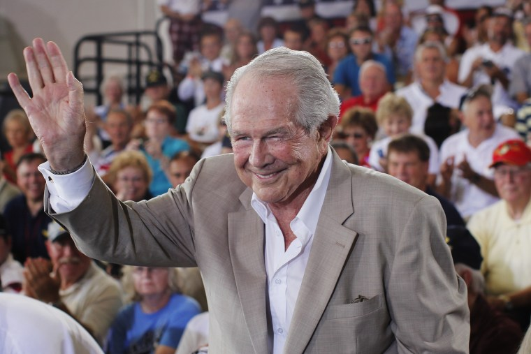 Evangelist Pat Robertson waves at the crowd during a campaign rally for Mitt Romney at the Military Aviation Museum in Virginia Beach, Va., Sept. 8, 2012.