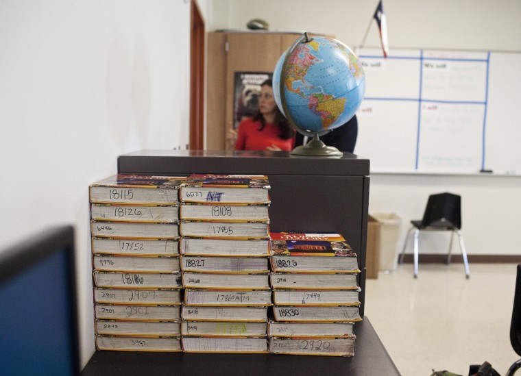 Textbooks, which are assigned and shared, in a classroom at Hutto High School in Hutto, Texas.