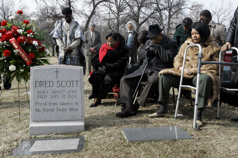 Descendants of Dred Scott and others gather at his grave site, in a, March 6, 2007 photo, at Calvary Cemetery in St. Louis, Mo.
