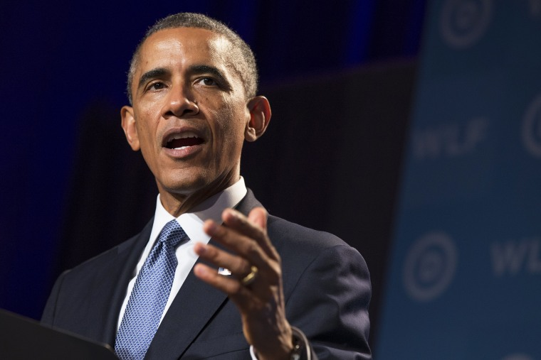 President Barack Obama gestures during remarks at the Democratic National Committee's Women's Leadership Forum on Sept. 19, 2014, in Washington, D.C. (Photo by Evan Vucci/AP)