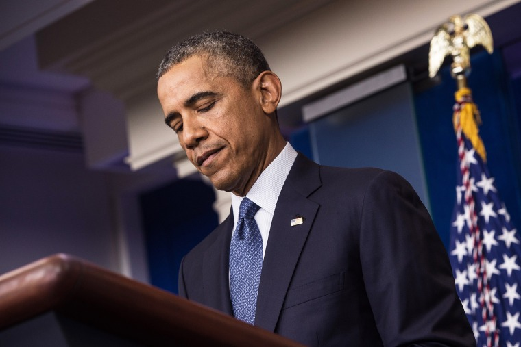 President Barack Obama pauses as he makes a statement in the briefing room of the White House on Aug. 1, 2014 in Washington, D.C.