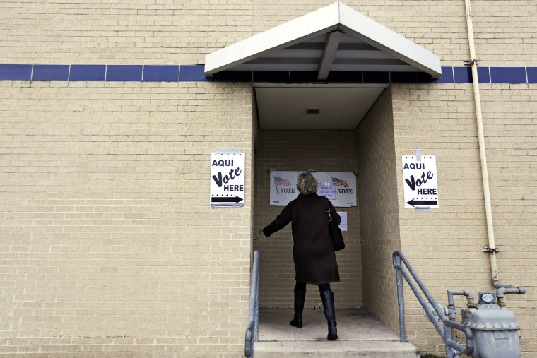 A voter arrives at a polling site, Tuesday, March 4, 2014, in San Antonio.