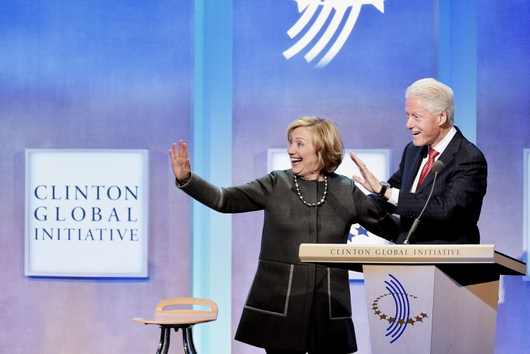 Former US Secretary of State Hillary Clinton and husband, Former U.S. President Bill Clinton address the audience during a meeting for the  Clinton Global Initiative on Sept. 22, 2014 in New York City.