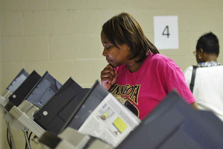 A women votes at the Henry Brigham Community Center in Augusta, Ga. on Oct. 27, 2012. (Photo by Jon-Michael Sullivan/Augusta Chronicle/ZUMA Press)