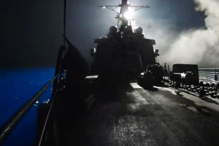 In this image made from video released by the U.S. Navy on Tuesday, Sept. 23, 2014, missiles bound for Syrian Islamic State group targets are launched off of a U.S. Navy ship.
