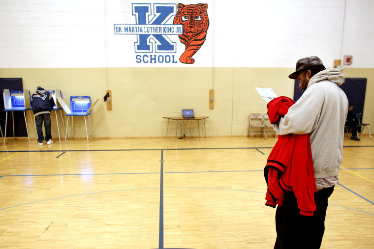 A man goes over his ballot at the Martin Luther King elementary school on November 6, 2012 in Milwaukee, Wisconsin.