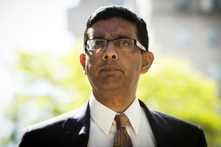 Conservative commentator and best-selling author, Dinesh D'Souza exits the Manhattan Federal Courthouse after pleading guilty in New York on May 20, 2014. (Photo by Lucas Jackson/Reuters)