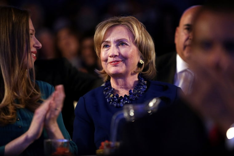Former U.S. Secretary of State Hillary Clinton watch from the audience as U.S. President Barack Obama, speaks at the Clinton Global Initiative on Sept. 23, 2014 in New York City.