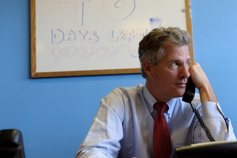 Scott Brown works the phone banks at the New Hampshire GOP Salem headquarters on Sept. 17, 2014 in Salem, N.H. (Photo by Darren McCollester/Getty)