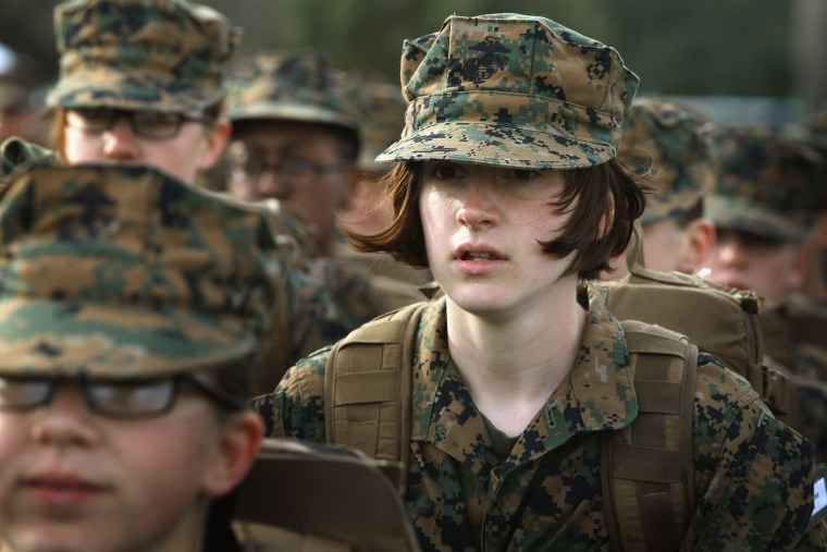 Marine Recruit Haley Evans from St Louis, Missouri stands in formation during boot camp February 27, 2013.