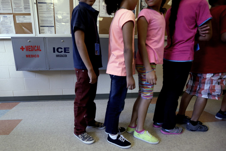 Detained immigrant children line up in the cafeteria at the Karnes County Residential Center, a temporary home for immigrant women and children detained at the border, on Sept. 10, 2014, in Karnes City, Texas.