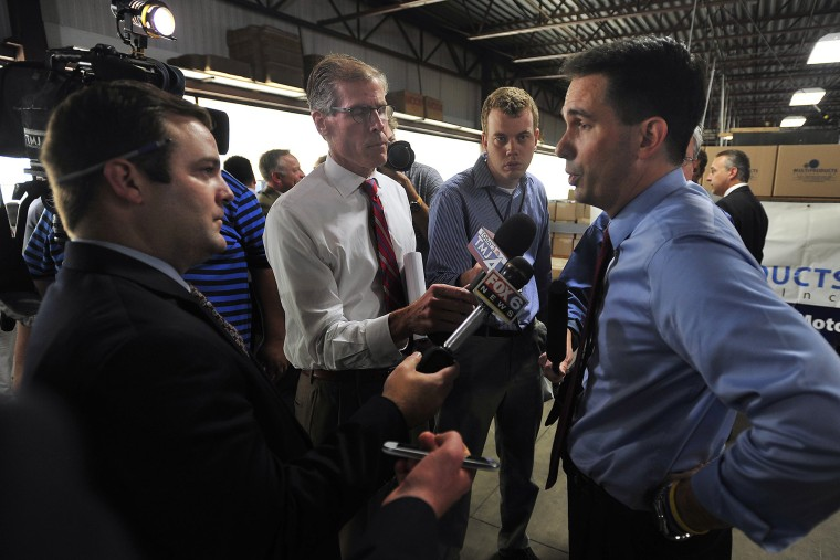 Gov. Scott Walker answers questions from print and television reporters during a campaign stop and tour at Multi Products Company, Inc. near Racine, Wisc. on Sept. 23, 2014.