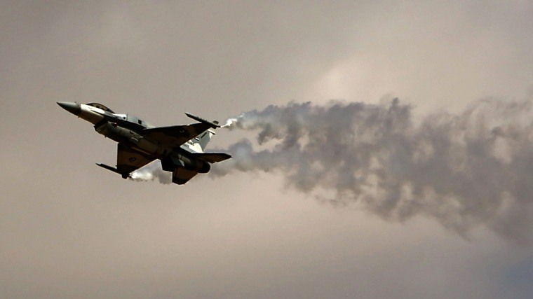 A General Dynamics F-16 Fighting Falcon jet belonging to the United Arab Emirates (UAE) Air Force performs during the Dubai Airshow on Nov. 18, 2013, in Dubai. (Photo by Marwan Naamani/AFP/Getty)