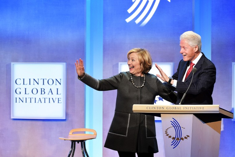 Former US Secretary of State Hillary Clinton and husband, Former U.S. President Bill Clinton address the audience during the Clinton Global Initiative on Sept. 22, 2014 New York, N.Y. (Photo by Michael Loccisano/Getty)