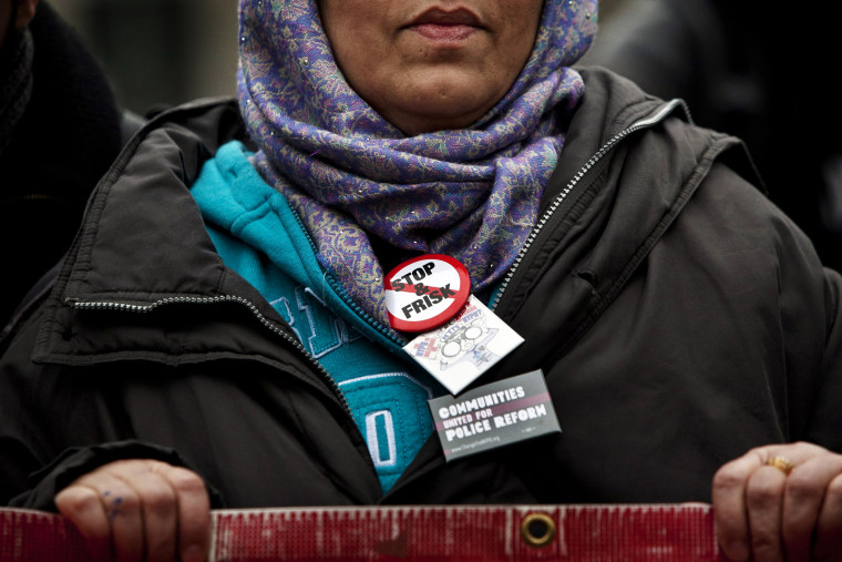 """A woman participates in a demonstration against the city's \""""stop and frisk\"""" searches in lower Manhattan near Federal Court March 18, 2013 in New York City."""