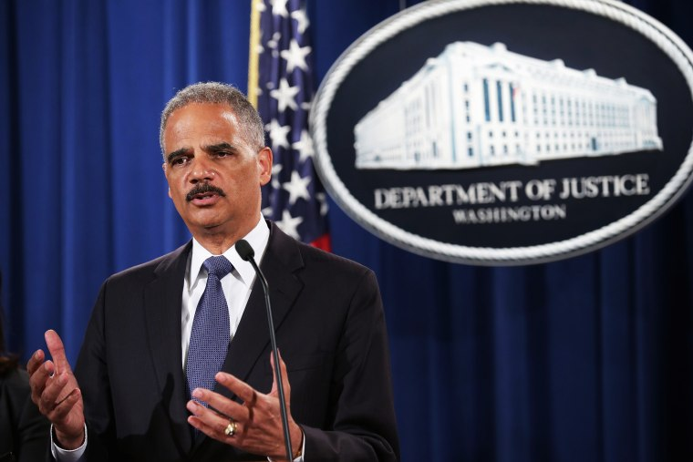 U.S. Attorney General Eric Holder announces a Justice Department 'patterns and practice' investigation of the Ferguson, Missouri, police department during a news conference at the department's headquarters September 4, 2014 in Washington, DC.