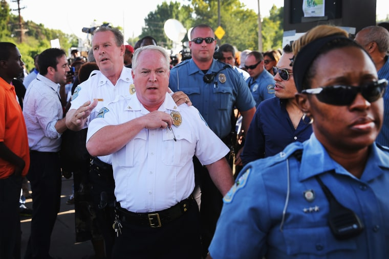 Ferguson Police Chief Thomas Jackson leaves the parking lot of a gas station, which was burned during rioting, after he announced the name of the Ferguson police officer responsible for the August 9, shooting death of teenager Michael Brown on August 15,