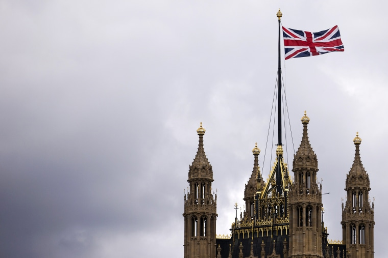 The Union flag flying above the Houses of Parliament where lawmakers are expected to vote in favour of joining air strikes against Islamic State (IS) militants in central London on 26 September, 2014. Photo by Justin Tallis/Getty.