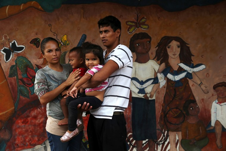 A family of immigrants arrives from Honduras to a shelter for undocumented immigrants on September 15, 2014 in Tenosique, Mexico.