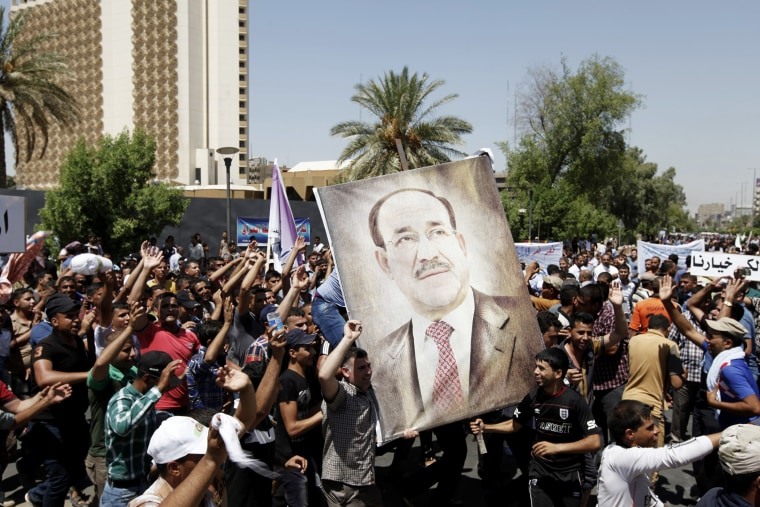 People carry portraits of Nuri al-Maliki as they gather in support of him in Baghdad on Aug. 13, 2014.