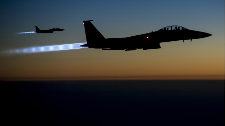 A pair of U.S. Air Force F-15E Strike Eagles fly over northern Iraq after conducting airstrikes in Syria, in this U.S. Air Force handout photo taken early in the morning of September 23, 2014. (Senior Airman Matthew Bruch/Handout/US Air Force/Reuters)