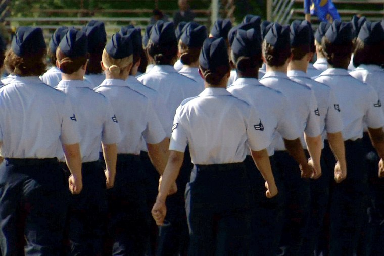 In this June 22, 2012, image made from video, female airmen march during graduation at Lackland Air Force Base in San Antonio, Texas. (Photo by John L. Mone/AP)