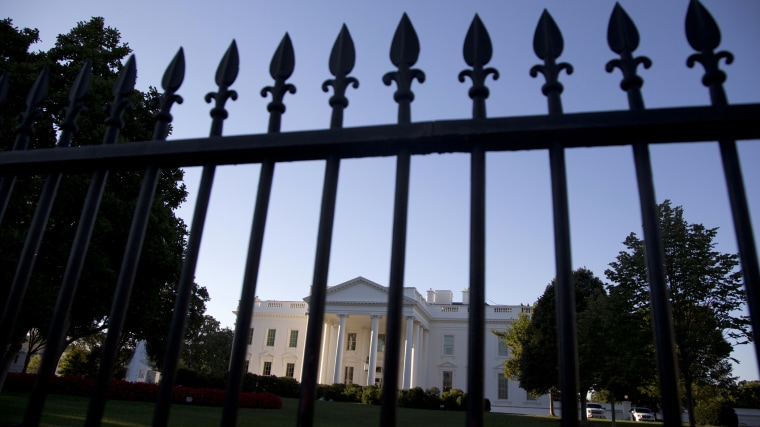 The perimeter fence along Pennsylvania Avenue outside the White House is seen in Washington, D.C., Sept. 22, 2014.  (Photo by Carolyn Kaster/AP)