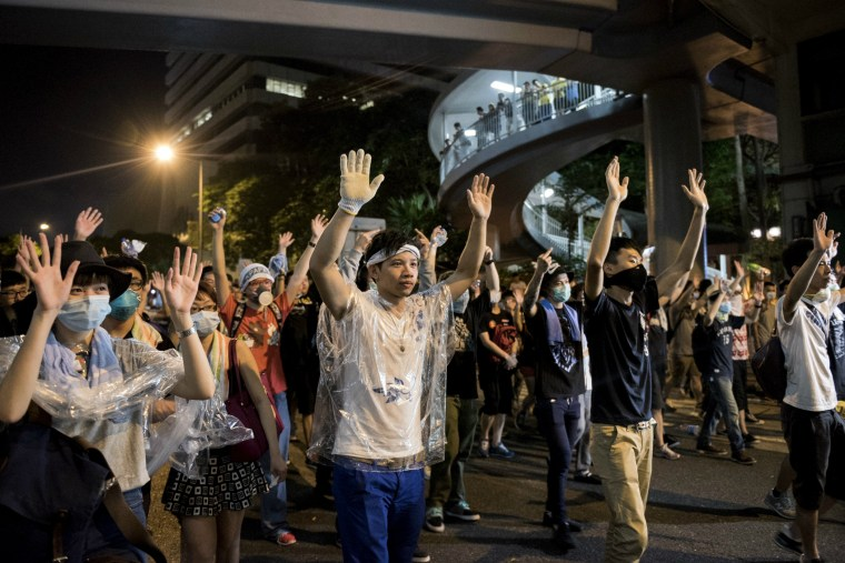 Pro-democracy protesters put their hands up in the air in front of the police in Hong Kong on Sept. 28, 2014.