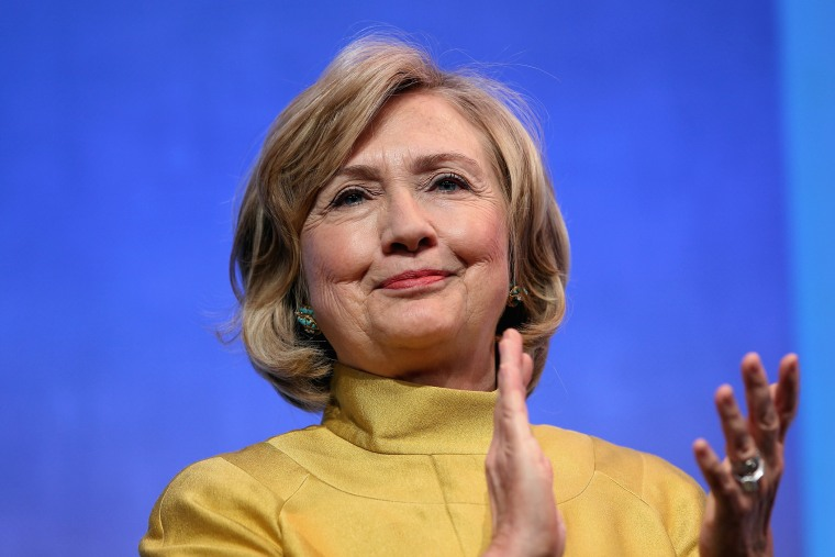 Former U.S. Secretary of State Hillary Clinton applauds on stage during the Clinton Global Initiative (CGI), on Sept. 24, 2014 in New York City.