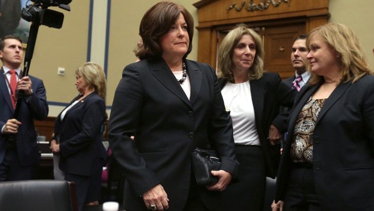 Secret Service Director Julia Pierson (C) arrives to testify to the House Oversight and Government Reform Committee on the White House perimeter breach at the Rayburn House Office Building on Sept. 30, 2014 in Washington, DC.