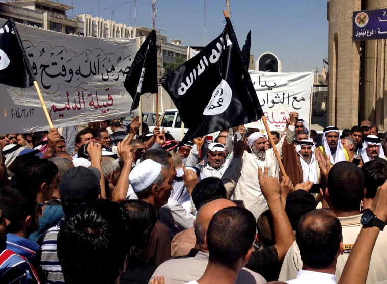 Demonstrators chant pro-al-Qaida-inspired Islamic State of Iraq and the Levant (ISIL) as they wave al-Qaida flags in front of the provincial government...