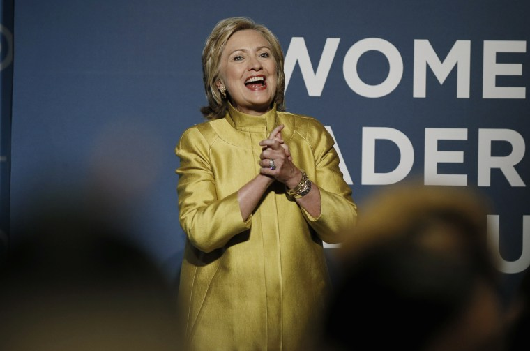 Former U.S. Secretary of State Clinton reacts to the cheers of the crowd as she arrives to address the DNC Women?s Leadership Forum?s annual Issues Conference in Washington