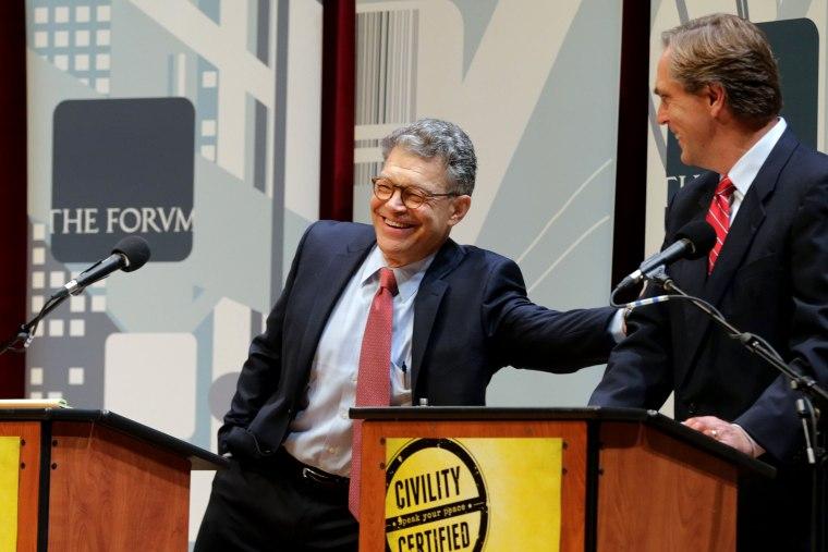 Democratic U.S. Sen. Al Franken, left, and Republican challenger Mike McFadden enjoy a laugh before their debate, on Oct. 1, 2014, in Duluth, Minn (Photo by Jim Mone/AP)