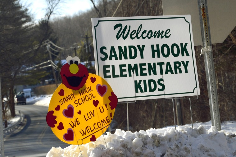 A sign welcoming children from Sandy Hook Elementry school sits on the road in Monroe, Connecticut on Jan. 3, 2013.