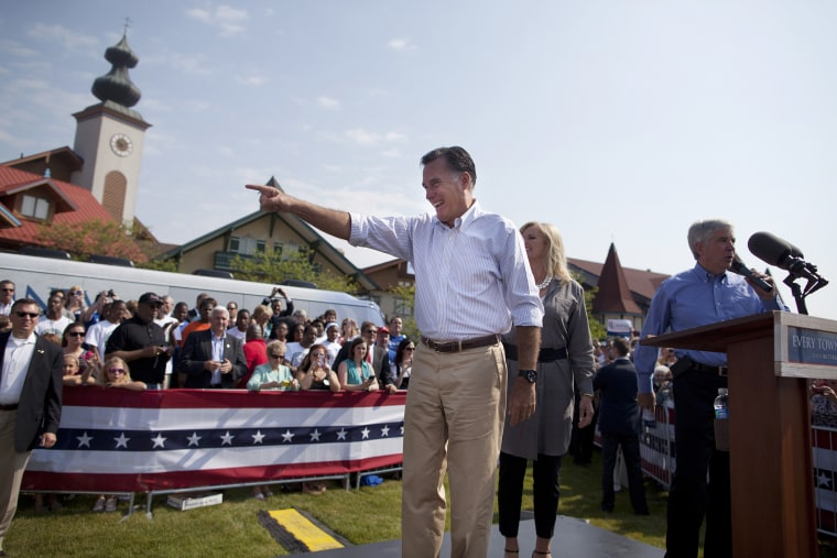 Mitt Romney, left, and his wife Ann, center, are introduced by Gov. Rick Snyder, R-Mich. during a campaign stop at Bavarian Inn Lodge on June 19, 2012 in Frankenmuth, Mich.
