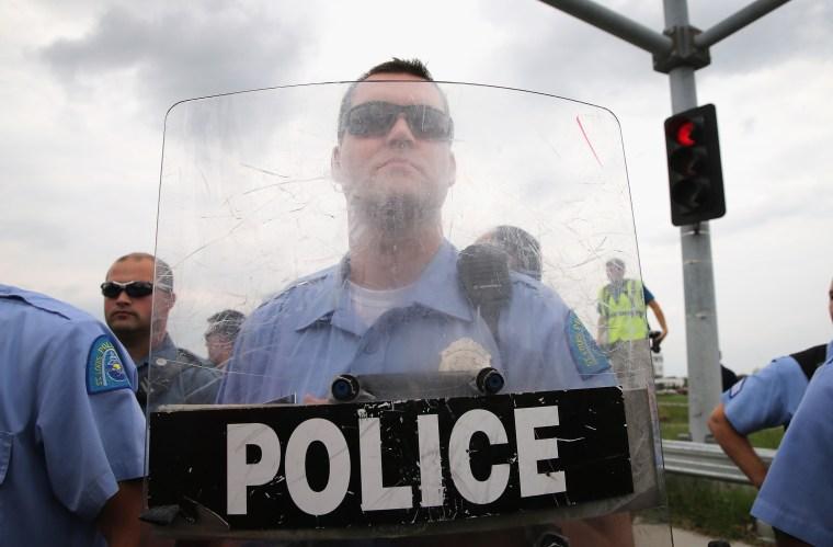 Police block demonstrators from gaining access to Interstate Highway 70 on September 10, 2014 near Ferguson, Missouri.