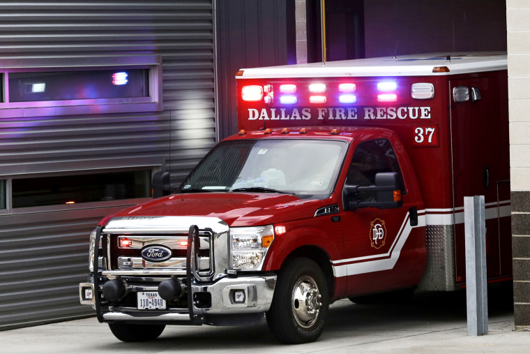 An ambulance pulls into the Dallas Fire-Rescue station 37 in Dallas, Wednesday, Oct. 1, 2014.