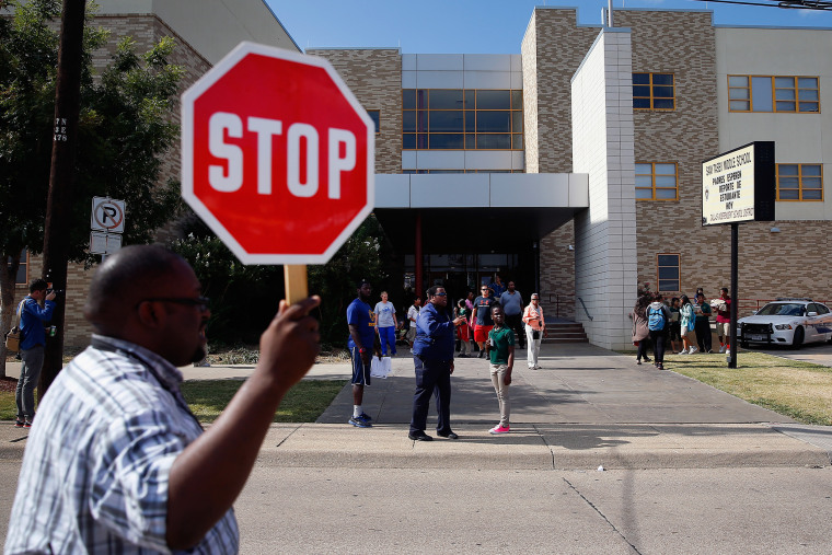 Students are dismissed from Sam Tasby Middle School on October 1, 2014 in Dallas, Texas. Officials confirmed that a student, who had contact with the first confirmed Ebola virus patient in the United States, attends classes at the school.
