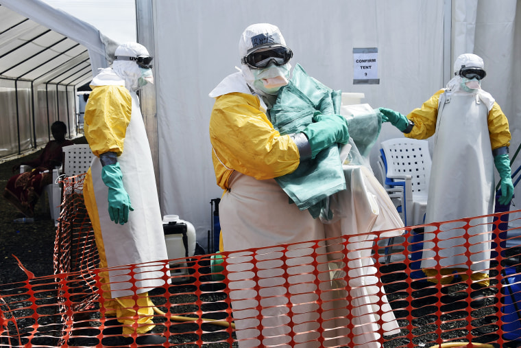 A health worker in protective suit carries equipment on October 1, 2014 at MSF's (Doctors Without Borders) Ebola treatment center in Monrovia.