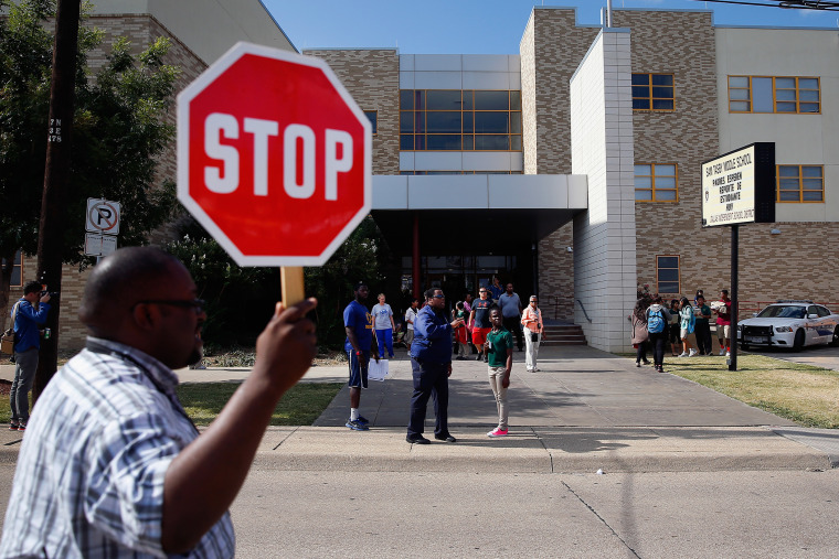Students are dismissed from Sam Tasby Middle School on Oct. 1, 2014 in Dallas, Texas. Officials confirmed that a student, who had contact with the first confirmed Ebola virus patient in the United States, attends classes at the school.