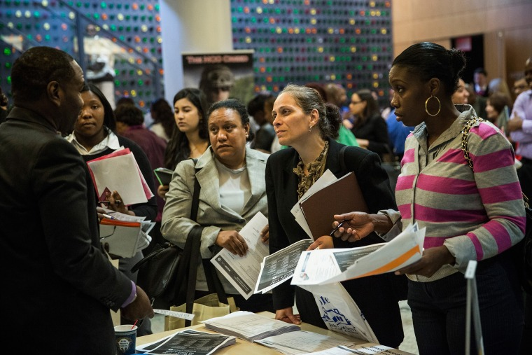 People attend a jobs fair at the Bronx Public Library on Sept. 17, 2014 in New York City.