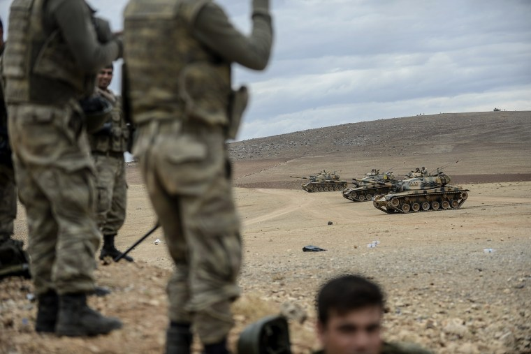 Turkish army tanks take position near the Syrian border on Sept. 29, 2014 in Suruc after three mortars hit the Turkish side.