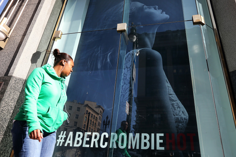 A woman stands near an Abercrombie and Fitch store on Feb. 22, 2013 in San Francisco, California.
